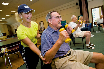 Mary Carroll Root helps participants during a Powerful Aging Exercise class at the Avon Senior Center.